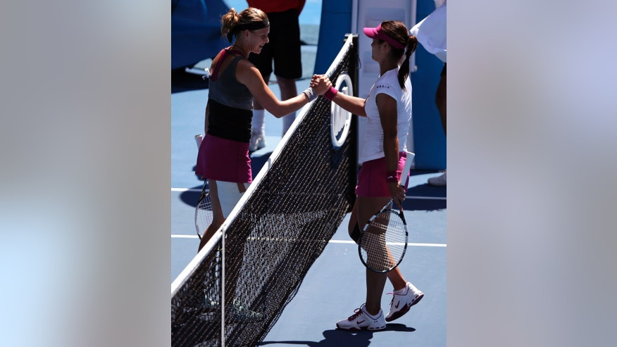 Li Na of China, right, shakes hands with  Lucie Safarova of the Czech Republic at the net after Li won their third round match against Li Na of China at the Australian Open tennis championship in Melbourne, Australia, Friday, Jan. 17, 2014.(AP Photo/Rick Rycroft)