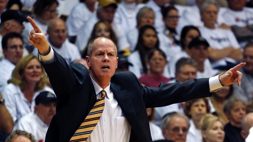 Colorado coach Tad Boyle gestures to his players during the second half of an NCAA college basketball game against UCLA in Boulder, Colo., Thursday, Jan. 16, 2014. UCLA won 69-56. (AP Photo/Brennan Linsley)