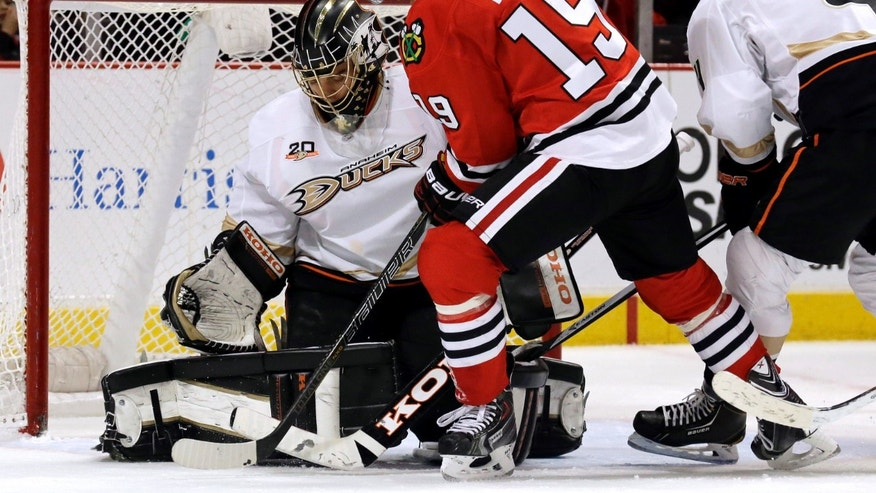 Chicago Blackhawks' Jonathan Toews (19) shoots against Anaheim Ducks goalie Jonas Hiller (10) during the second period of an NHL hockey game in Chicago, Friday, Jan. 17, 2014. (AP Photo/Nam Y. Huh)