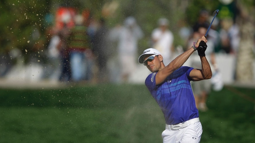 Rafa Cabrera-Bello of Spain plays a bunker shot on the 1st hole during the 2nd round of the Abu Dhabi HSBC Golf Championship in Abu Dhabi, United Arab Emirates, Friday, Jan. 17, 2014. (AP Photo/Kamran Jebreili)