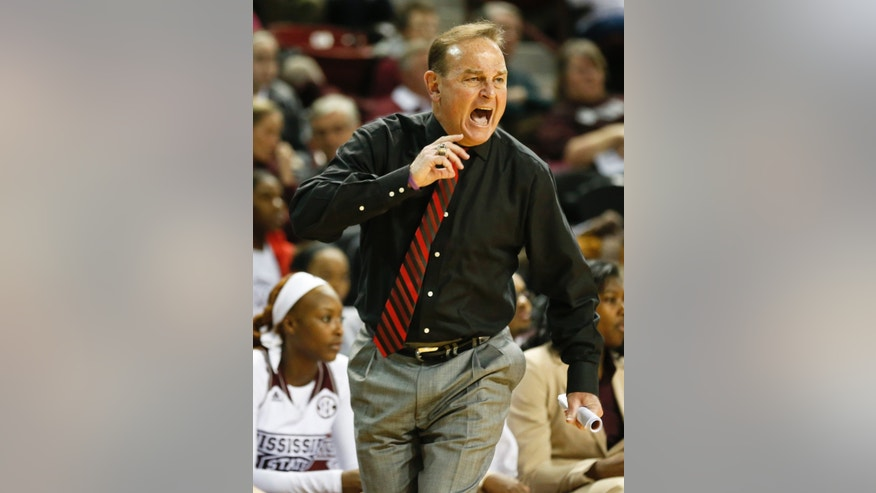 Mississippi State women's basketball coach Vic Schaefer calls out to his players in the first half of an NCAA college basketball game against Tennessee in Starkville, Miss., Thursday, Jan. 16, 2014. (AP Photo/Rogelio V. Solis)