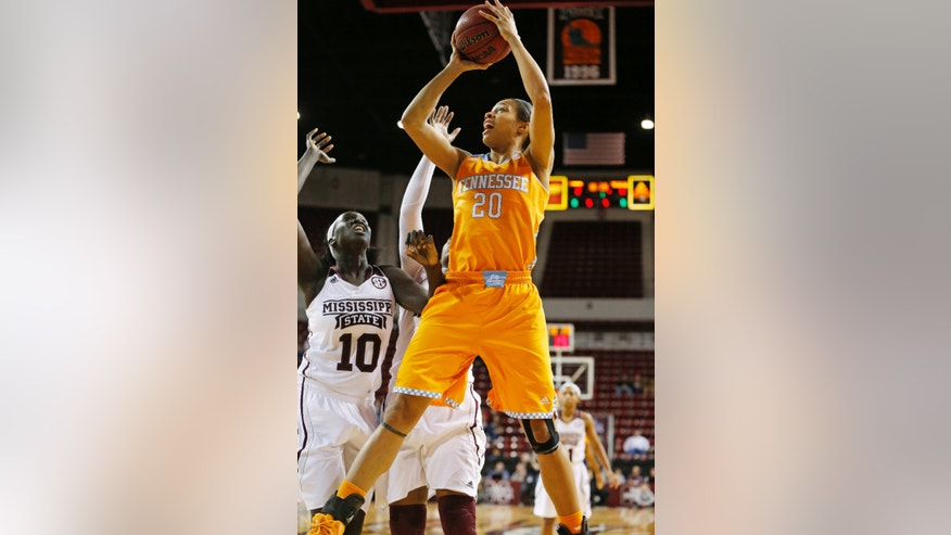 Tennessee center Isabelle Harrison (20) shoots at the basket past the defense of Mississippi State center Martha Alwal (10) in the first half of an NCAA college basketball game in Starkville, Miss., Thursday, Jan. 16, 2014. (AP Photo/Rogelio V. Solis)