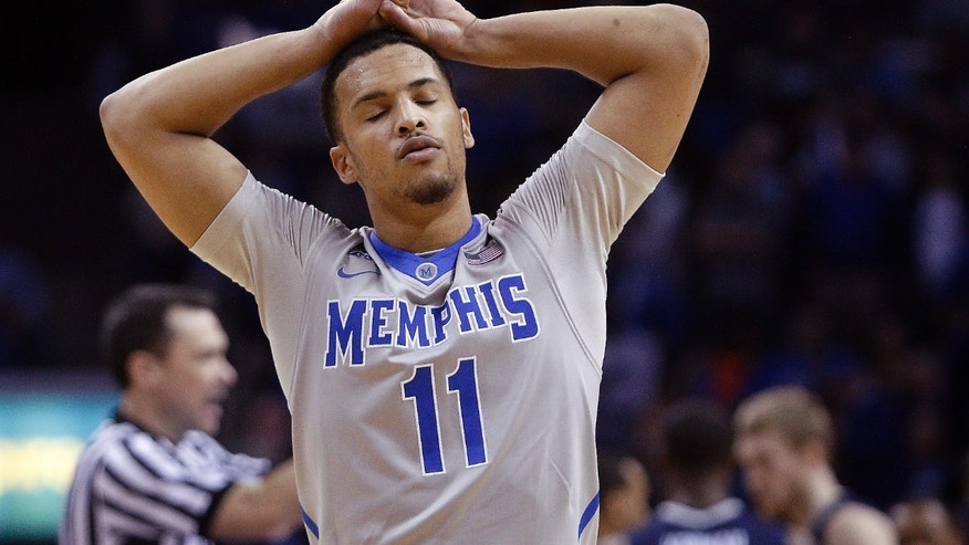 Memphis guard Michael Dixon, Jr. (11) reacts to fouling out against Connecticut in the second half of an NCAA college basketball game, Thursday, Jan. 16, 2014, in Memphis, Tenn. Connecticut won 83-73. (AP Photo/Lance Murphey)