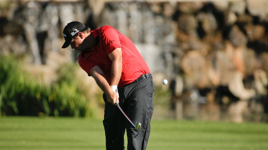Patrick Reed hits to the 18th green during the second round of the Humana Challenge golf tournament at La Quinta Country Club on Friday, Jan. 17, 2014, in La Quinta, Calif. (AP Photo/Chris Carlson)