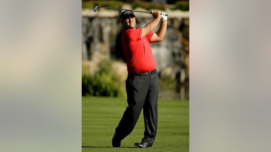 Patrick Reed watches his shot to the 18th green during the second round of the Humana Challenge golf tournament at La Quinta Country Club on Friday, Jan. 17, 2014, in La Quinta, Calif. (AP Photo/Chris Carlson)