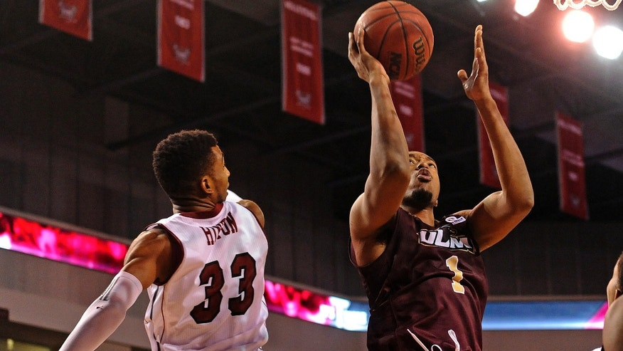 Louisiana-Monroe forward Jayon James (1) goes up to shoot past Troy forward/center Westley Hinton (33) during the second half of an NCAA college basketball game in Troy, Ala., Thursday, Jan. 16, 2014. Louisiana-Monroe won 75-64. (AP Photo/The (Troy) Messenger, Thomas Graning)