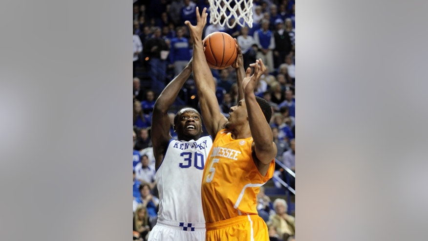 Kentucky's Julius Randle, left, shoots under pressure from Tennessee's Jarnell Stokes (5) during the first half of an NCAA college basketball game, Saturday, Jan. 18, 2014, in Lexington, Ky. (AP Photo/James Crisp)
