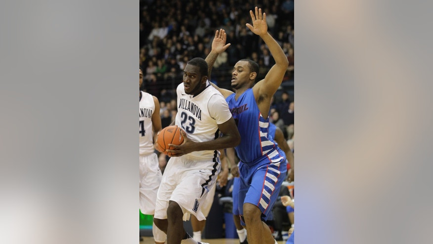 Villanova's Daniel Ochefu (23) drives to the basket past DePaul's Tommy Hamilton IV in the first half of an NCAA college basketball game on Saturday, Jan. 18, 2014, in Villanova, Pa. (AP Photo/Laurence Kesterson)
