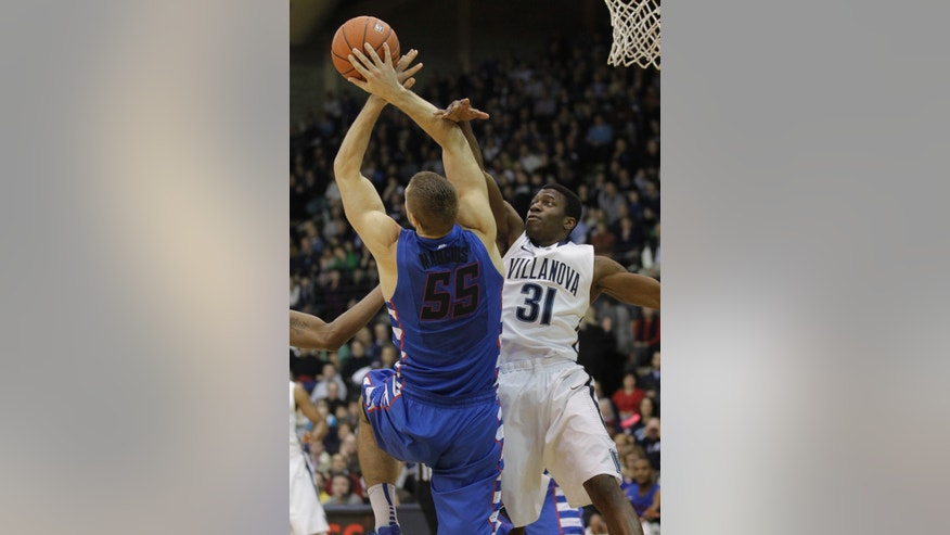 Villanova's Dylan Ennis (31) and DePaul's Sandi Marcius (55) fight for a rebound under the Villanova basket in the first half of an NCAA college basketball game on Saturday, Jan. 18, 2014, in Villanova, Pa. (AP Photo/Laurence Kesterson)
