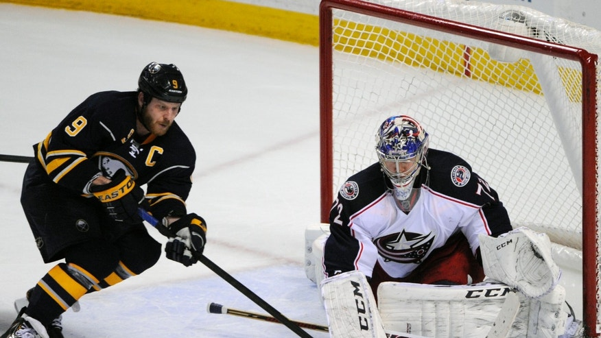Buffalo Sabres center Steve Ott (9) moves the puck in front of Columbus Blue Jackets goaltender Sergei Bobrovsky (72), of Russia, during the overtime session of an NHL hockey game in Buffalo, N.Y., Saturday, Jan.18, 2014.  The Blue Jackets won 4-3 in a shootout. (AP Photo/Gary Wiepert)