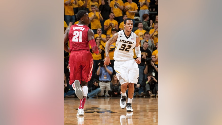Missouri's Jabari Brown, right, smiles as he runs up court in front of Alabama's Rodney Cooper, left, after Brown made a 3-point shot during the first half of an NCAA college basketball game Saturday, Jan. 18, 2014, in Columbia, Mo. (AP Photo/L.G. Patterson)