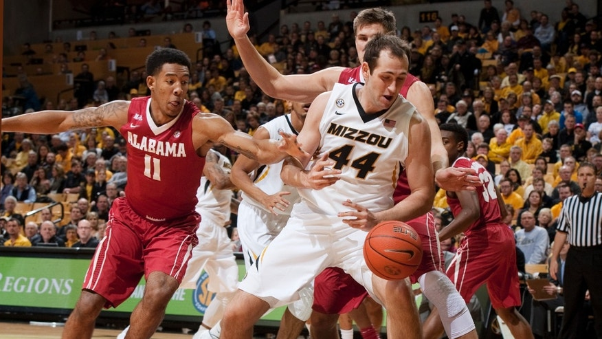 Missouri's Ryan Rosburg (44) has the ball knocked away by Alabama's Shannon Hale, left, as he tries to pull in a rebound during the first half of an NCAA college basketball game Saturday, Jan. 18, 2014, in Columbia, Mo. (AP Photo/L.G. Patterson)