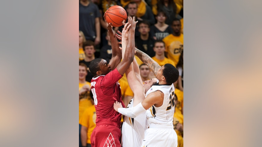 Alabama's Jimmie Taylor, left, battles Missouri's Ryan Rosburg, center, and Jabari Brown, right, for a rebound during the first half of an NCAA college basketball game Saturday, Jan. 18, 2014, in Columbia, Mo. (AP Photo/L.G. Patterson)
