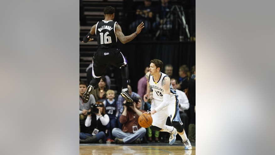 Memphis Grizzlies forward Mike Miller (13) drives to the basket after faking out Sacramento Kings guard Ben McLemore (16) in the first half of an NBA basketball game on Friday, Jan. 17, 2014, in Memphis, Tenn. (AP Photo/Lance Murphey)