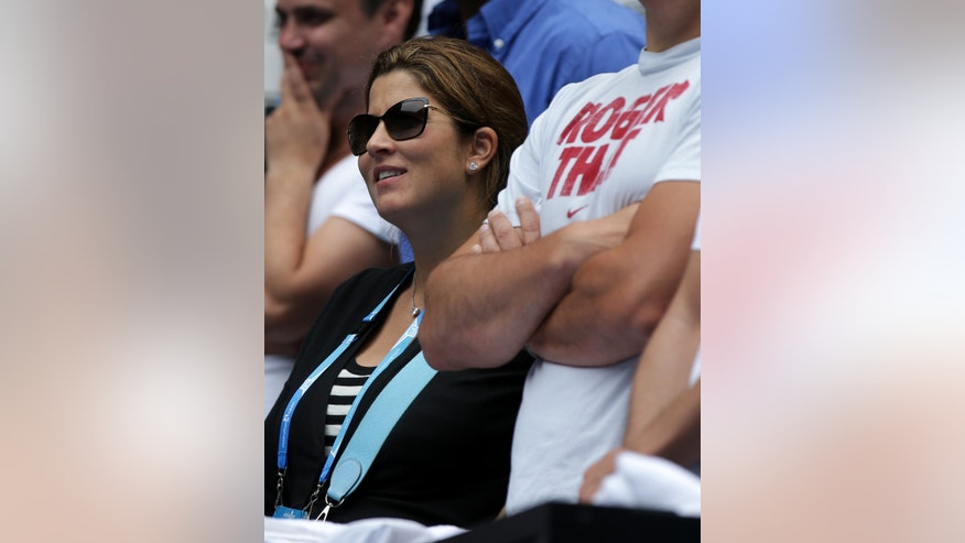 Mirka Federer, wife of Switzerland's Roger Federer, watches his match against Teymuraz Gabashvili of Russia during their third round match at the Australian Open tennis championship in Melbourne, Australia, Saturday, Jan. 18, 2014.(AP Photo/Aaron Favila)