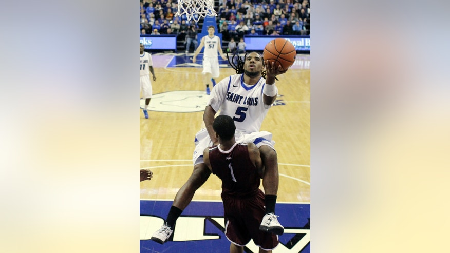 Saint Louis' Jordair Jett (5) heads to the basket as Fordham's Mandell Thomas defends during the first half of an NCAA college basketball game Saturday, Jan. 18, 2014, in St. Louis. (AP Photo/Jeff Roberson)