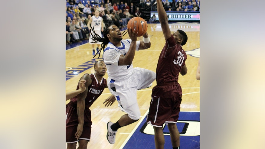 Saint Louis' Jordair Jett, center, heads to the basket as Fordham's Mandell Thomas, left, and Ryan Rhoomes defend during the first half of an NCAA college basketball game Saturday, Jan. 18, 2014, in St. Louis. (AP Photo/Jeff Roberson)
