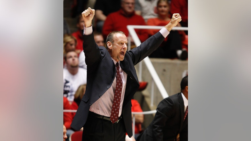 Utah's head coach Larry Krystkowiak calls a play against UCLA during the first half of an NCAA college basketball game in Salt Lake City, Saturday, Jan. 18, 2014.  (AP Photo/George Frey)