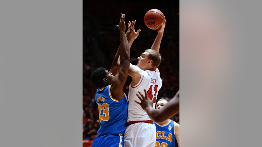 UCLA's Tony Parker, left, defends Utah's Jeremy Olsen during the first half of an NCAA college basketball game in Salt Lake City, Saturday, Jan. 18, 2014. (AP Photo/George Frey)