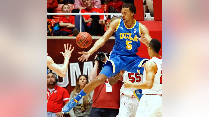 UCLA's Kyle Anderson loses control of the ball during the first half of an NCAA college basketball game against Utah in Salt Lake City, Saturday, Jan. 18, 2014. (AP Photo/George Frey)