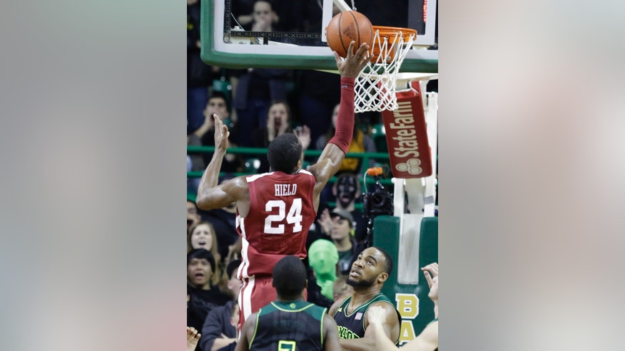Buddy Hield (24) scores over Baylor forward Rico Gathers (2) during the second half of an NCAA college basketball game Saturday, Jan. 18, 2014, in Waco, Texas. Oklahoma won 66-64. (AP Photo/LM Otero)