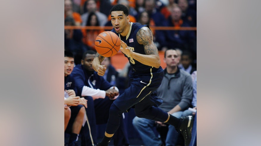 Pittsburgh's Cameron Wright looks to pass the ball in the first half of an NCAA college basketball game against Syracuse on Saturday, Jan. 18, 2014, in Syracuse, N.Y. (AP Photo/Nick Lisi)