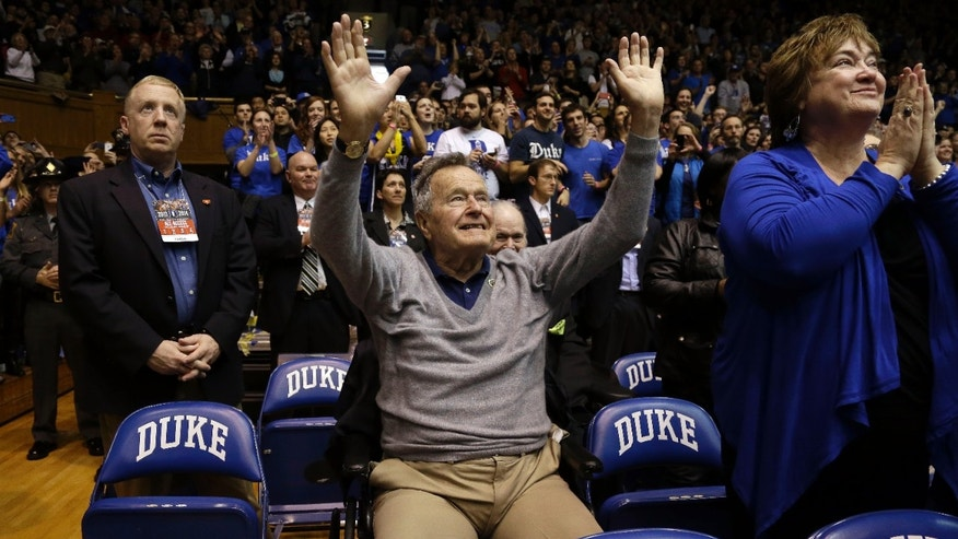 Former President George H.W. Bush is introduced during the first half of an NCAA college basketball game between Duke and North Carolina State at Cameron Indoor Stadium in Durham, N.C., Saturday, Jan. 18, 2014. (AP Photo/Gerry Broome)