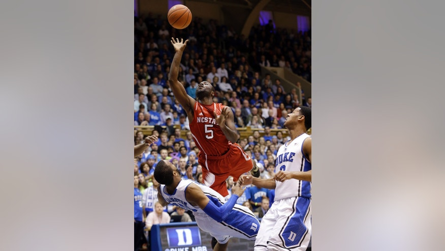 Duke's Josh Hairston, left, defends against North Carolina State's Desmond Lee (5) during the first half of an NCAA college basketball game in Durham, N.C., Saturday, Jan. 18, 2014. (AP Photo/Gerry Broome)