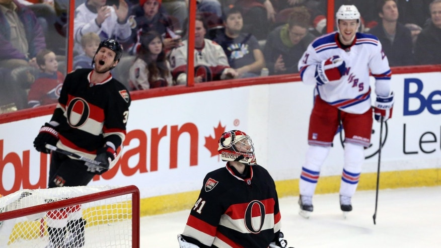 Ottawa Senators goaltender Craig Anderson (41) and teammate defenceman Marc Methot (3) react as New York Rangers Derek Stepan (21) celebrates his goal during the second period of an NHL hockey game in Ottawa, Saturday, Jan. 18, 2014. (AP Photo/The Canadian Press, Fred Chartrand)