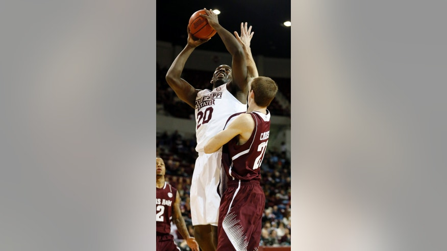 Mississippi State forward Gavin Ware (20) shoots over Texas A&M guard Alex Caruso (21) during the first half of an NCAA college basketball game in Starkville, Miss., Saturday, Jan. 18, 2014.  (AP Photo/Rogelio V. Solis)