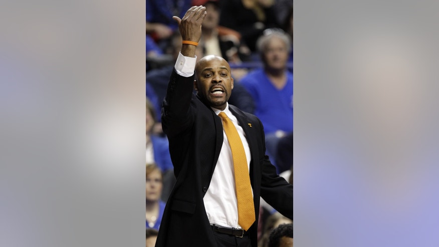 Tennessee head coach Cuonzo Martin calls a play during the first half of an NCAA college basketball game against Kentucky, Saturday, Jan. 18, 2014, in Lexington, Ky. (AP Photo/James Crisp)