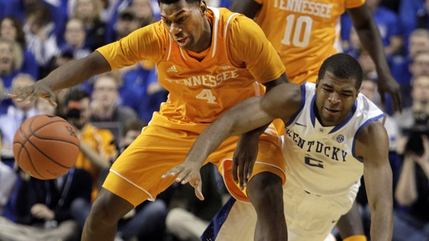 Tennessee's Armani Moore (4) is pressured by Kentucky's  Aaron Harrison (2) during the second half of an NCAA college basketball game, Saturday, Jan. 18, 2014, in Lexington, Ky. Kentucky won 74-66. (AP Photo/James Crisp)