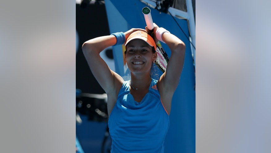 Ana Ivanovic of Serbia celebrates her win over Serena Williams of the U.S. during their fourth round match at the Australian Open tennis championship in Melbourne, Australia, Sunday, Jan. 19, 2014.(AP Photo/Aaron Favila)