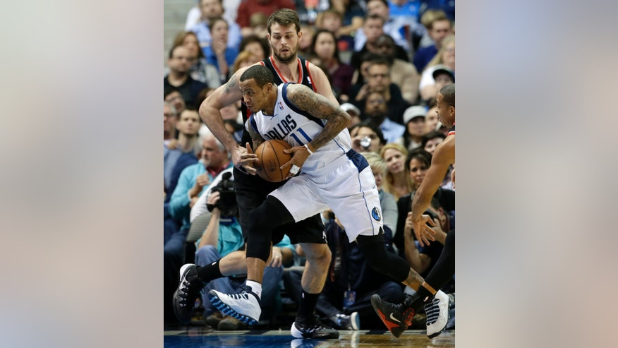 Portland Trail Blazers center Joel Freeland defends against a drive to the basket by Dallas Mavericks' Monta Ellis (11) during the first half of an NBA basketball game, Saturday, Jan. 18, 2014, in Dallas. (AP Photo/Tony Gutierrez)