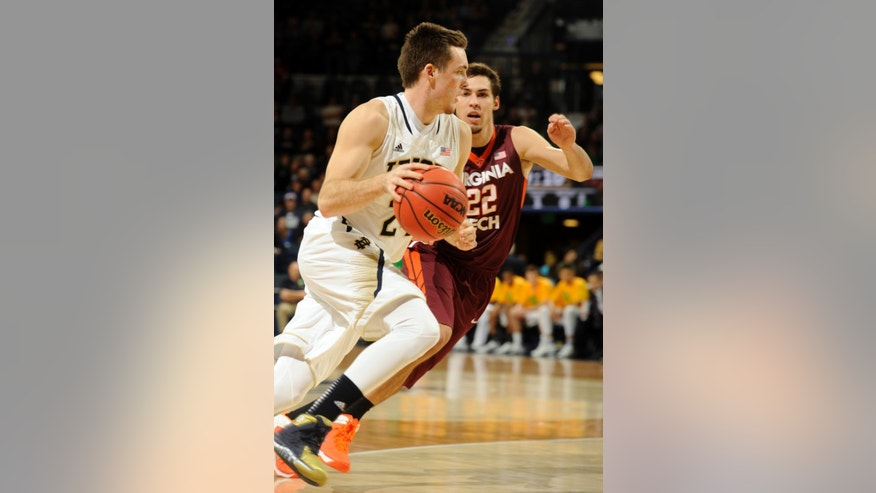 Notre Dame Pat Connaughton, left, drives the lane as Virginia Tech forward Christian Beyer defends during the first half of an NCAA college basketball game, Sunday, Jan. 19, 2014 in South Bend, Ind. (AP Photo/Joe Raymond)