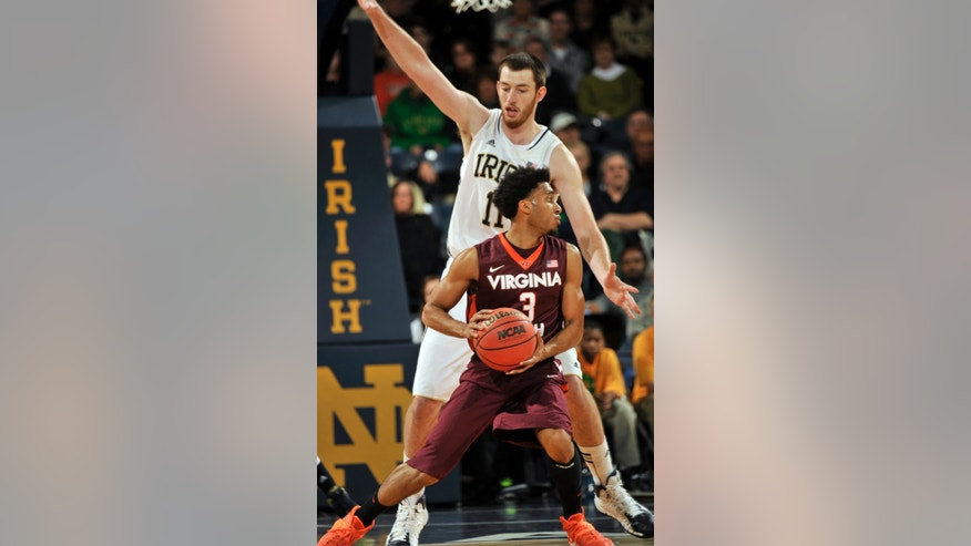 Virginia Tech guard Adam Smith drives the lane as Notre Dame forward Garrick Sherman defends during the first half of an NCAA college basketball game, Sunday, Jan. 19, 2014 in South Bend, Ind. (AP Photo/Joe Raymond)