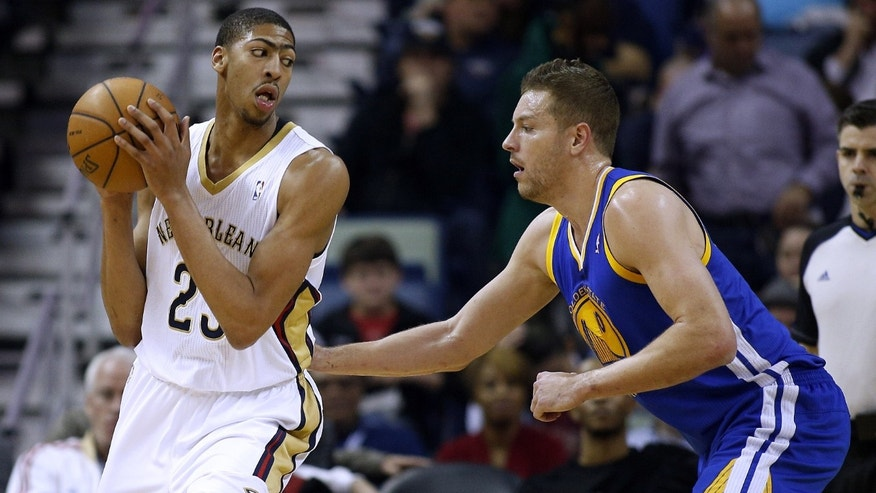 New Orleans Pelicans power forward Anthony Davis (23) drives against Golden State Warriors power forward David Lee during the first half of the NBA basketball game in New Orleans, Saturday, Jan. 18, 2014. (AP Photo/Jonathan Bachman)