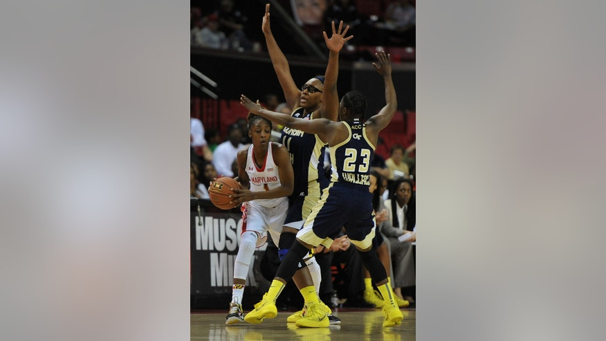 Maryland's Laurin Mincy, left, is double-teamed by Georgia Tech's Nariah Taylor, center, and Sydney Wallace in the first half of an NCAA college basketball game on Sunday, Jan. 19, 2014, in College Park, Md. Maryland won 92-81. (AP Photo/Gail Burton)