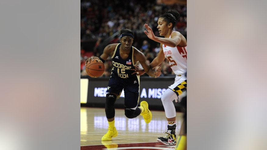 Georgia Tech's Tyaunna Marshall, left, drives the ball against Maryland's Alyssa Thomas in the second half of an NCAA college basketball gameon Sunday, Jan. 19, 2014, in College Park, Md. Maryland won 92-81. (AP Photo/Gail Burton)