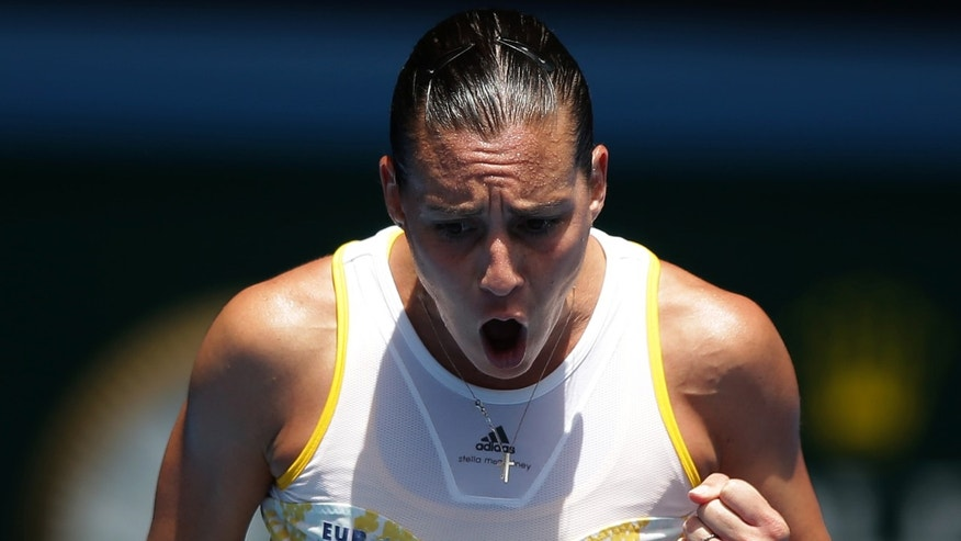 Flavia Pennetta reacts during her fourth round match against Angelique Kerber of Germany at the Australian Open tennis championship in Melbourne, Australia, Sunday, Jan. 19, 2014.(AP Photo/Aaron Favila)