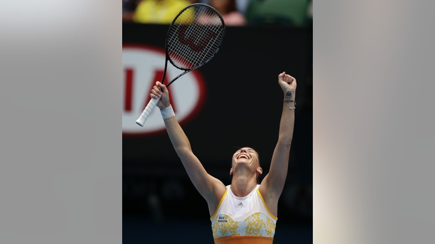 Flavia Pennetta of Italy celebrates after winning over Angelique Kerber of Germany during their fourth round match at the Australian Open tennis championship in Melbourne, Australia, Sunday, Jan. 19, 2014.(AP Photo/Aaron Favila)