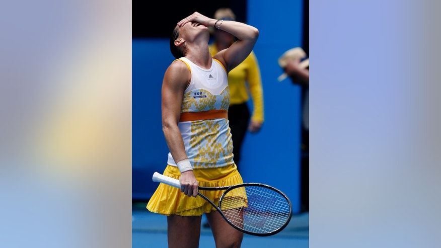 Flavia Pennetta of Italy celebrates after winning over Angelique Kerber of Germany during their fourth round match at the Australian Open tennis championship in Melbourne, Australia, Sunday, Jan. 19, 2014.(AP Photo/Eugene Hoshiko)
