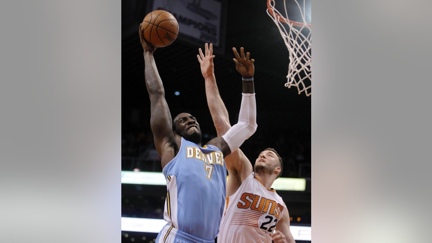 Denver Nuggets power forward J.J. Hickson (7) shoots over Phoenix Suns center Miles Plumlee (22) in the first quarter during an NBA basketball game, Sunday, Jan. 19, 2014, in Phoenix. (AP Photo/Rick Scuteri)