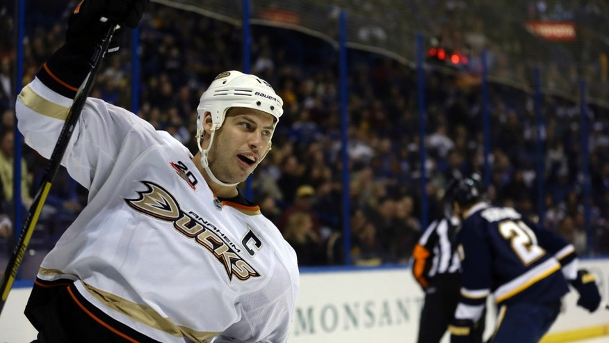 Anaheim Ducks' Ryan Getzlaf, left, celebrates after scoring as St. Louis Blues' Patrik Berglund, of Sweden, skates in the background during the first period of an NHL hockey game, Saturday, Jan. 18, 2014, in St. Louis. (AP Photo/Jeff Roberson)