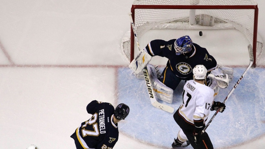 Anaheim Ducks' Ryan Getzlaf (15) watches as his shot slips past St. Louis Blues goalie Brian Elliott for a goal during the first period of an NHL hockey game on Saturday, Jan. 18, 2014, in St. Louis. Ducks' Dustin Penner (17), Blues' Alex Pietrangelo (27) and Blues' Patrik Berglund (21), of Sweden, watch the play. (AP Photo/Jeff Roberson)