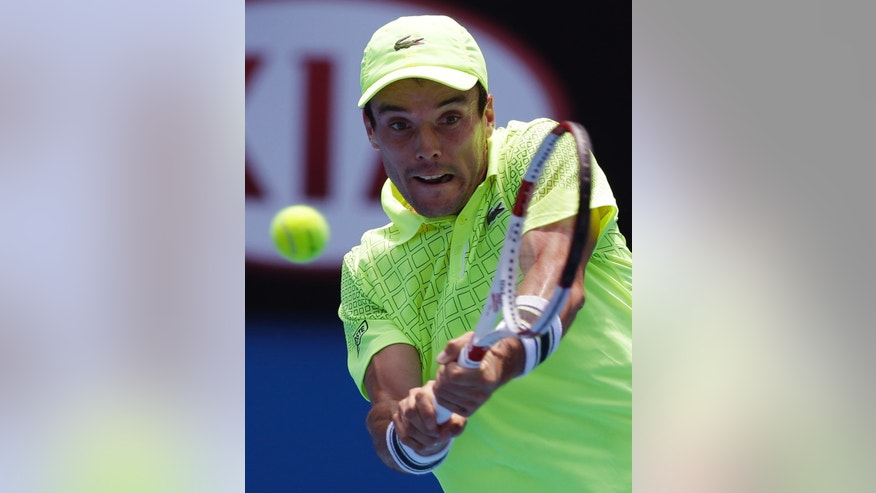 Roberto Bautista Agut of Spain hits a backhand return to Grigor Dimitrov of Bulgaria during their fourth round match at the Australian Open tennis championship in Melbourne, Australia, Monday, Jan. 20, 2014.(AP Photo/Aijaz Rahi)