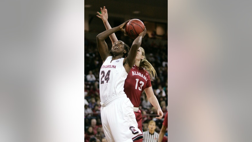 South Carolina's Aleighsa Welch (24) drives for the basket as Alabama's Nikki Hegstetter (13) tries to block during the first half of their NCAA college basketball game Sunday, Jan. 19, 2014, in Columbia, SC. (AP Photo/Mary Ann Chastain)