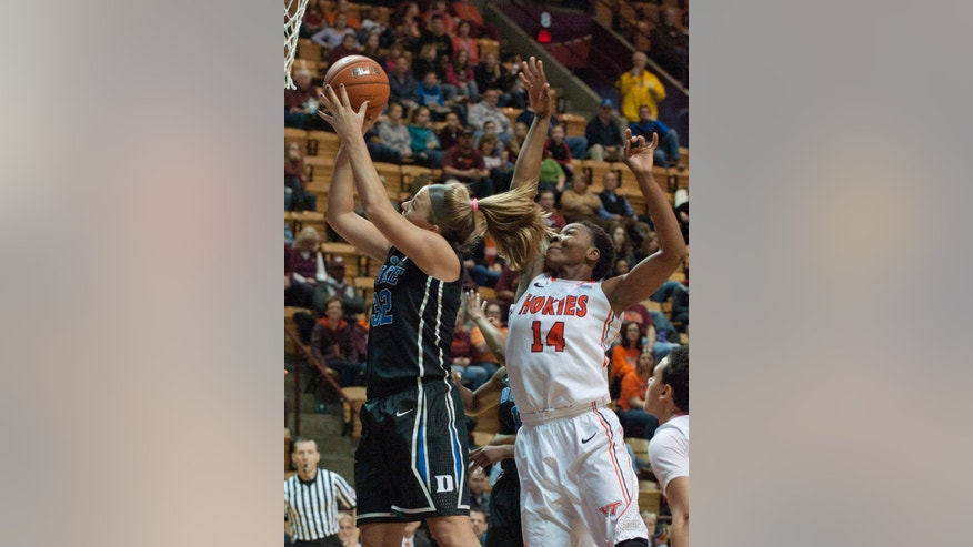 Duke's Tricia Liston goes up for a basket against  Virginia Tech's Uju Ugoka during the first half of an NCAA college basketball game on Sunday, Jan. 19, 2014, in Blacksburg, Va. Duke won 74-70. (AP Photo/Don Petersen)