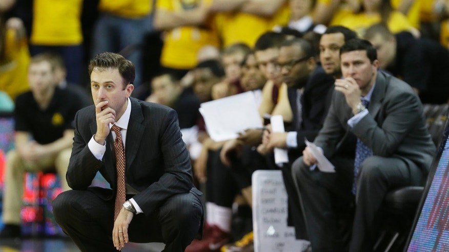 Minnesota head coach Richard Pitino, left, looks on during the second half of an NCAA college basketball game against Iowa, Sunday, Jan. 19, 2014, in Iowa City, Iowa. Iowa won 94-73. (AP Photo/Charlie Neibergall)