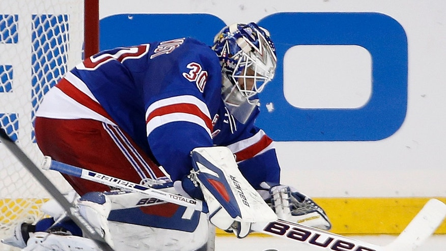 New York Rangers goalie Henrik Lundqvist (30) of Sweden makes a save in the second period of their NHL hockey game against the Washington Capitals at Madison Square Garden in New York, Sunday, Jan. 19, 2014. (AP Photo/Kathy Willens)